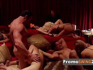american couples play sexual games to warm up before getting into the red orgy room